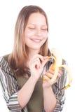Happy teen girl with banana Stock Image