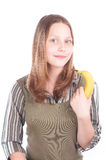 Happy teen girl with banana Royalty Free Stock Photography