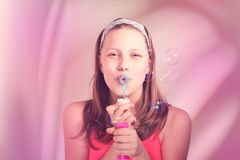 Happy teen girl blowing soap bubbles Royalty Free Stock Photos