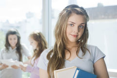Happy teen girl with books Stock Image