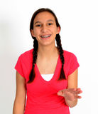 Happy teen girl with braids with hand out. Happy teen girl with hand out toward camera Stock Photos
