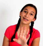 Happy teen girl with braids with hand out. Happy teen girl with hand out toward camera Stock Photo