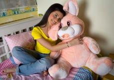 Happy teen girl with bunny toy. Happy teen girl huging bunny toy Royalty Free Stock Photo