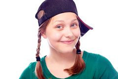 Happy teen girl in cap Stock Photo