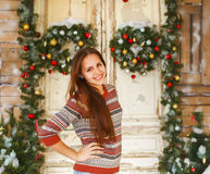 Happy teen girl by the Christmas decorations Stock Photography