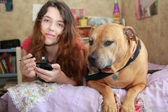 Happy teen girl  dog  Royalty Free Stock Photos
