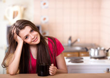 Happy teen girl drinking coffee at home Royalty Free Stock Photo