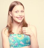 Happy teen girl gesturing Royalty Free Stock Photography