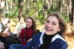Happy teen girl with a group of friends. Group of teenage girls on vacation during a trip in the forest stock photography