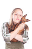 Happy teen girl with her dog Royalty Free Stock Photos