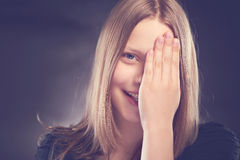 Happy teen girl with her hand on face Royalty Free Stock Photos