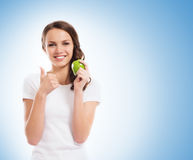 A happy teen girl holding a green apple Stock Photography