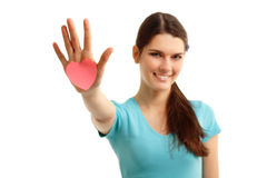 Happy teen girl holding in hand heart Stock Photos