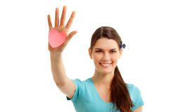 Happy teen girl holding in hand heart love Royalty Free Stock Image