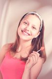Happy teen girl holding lollipop Royalty Free Stock Images