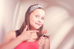 Happy teen girl holding lollipop Stock Photography