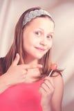 Happy teen girl holding lollipop Royalty Free Stock Photo