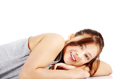Happy teen girl lying on her tummy Stock Image