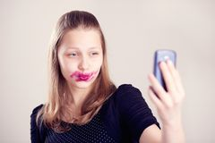 Happy teen girl make pictures of herself Royalty Free Stock Photo