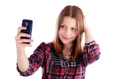 Happy teen girl make pictures of herself Stock Images