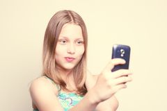 Happy teen girl make pictures of herself Stock Photos