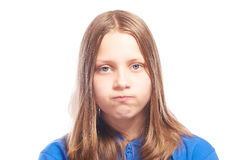 Happy teen girl making funny faces. Studio shot Royalty Free Stock Images