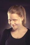 Happy teen girl making funny faces. Studio shot Stock Photos