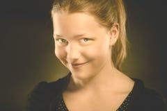 Happy teen girl making funny faces. Studio shot Royalty Free Stock Photo