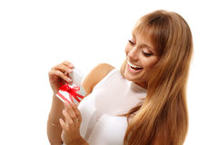 Happy teen girl opening valentine gift. Isolated on white background Stock Photo