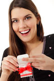 Happy teen girl opening valentine gift Royalty Free Stock Images