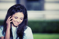 Happy teen girl on the phone Royalty Free Stock Photography