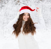 Happy teen girl with red santa hat Royalty Free Stock Photos