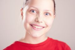 Happy teen girl with scrub mask on her face Royalty Free Stock Photo