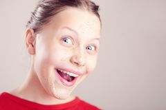 Happy teen girl with scrub mask on her face Stock Photos