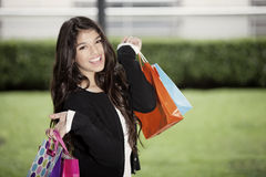 Happy teen girl with shopping bags Royalty Free Stock Photos