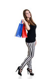 Happy teen girl with shopping bags. On white background Royalty Free Stock Photography