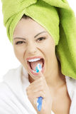 Happy teen girl singing to tooth brush Stock Photos