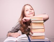 Happy teen girl sitting with books Stock Photography