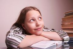 Happy teen girl sitting with books Stock Images