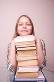 Happy teen girl sitting with books Stock Photos