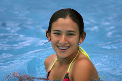 Happy teen girl smiling. Happy teen girl with braces in the pool Stock Photo