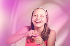 Happy teen girl with soap bubbles Stock Images