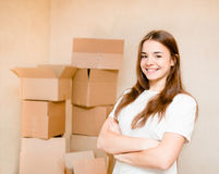 Happy teen girl standing on a background of cardboard Royalty Free Stock Photos