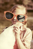 Happy teen girl in sunglasses eating cotton candy outdoor Stock Photos