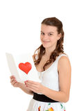 Happy teen girl with valentines card Royalty Free Stock Photos