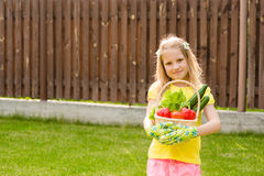 Happy teen girl with vegetables in basket Royalty Free Stock Images