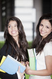 Happy teen girls with books. Happy teen girls smiling with books, back to school Stock Photo