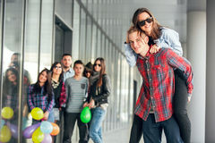 Happy teen girls and boys having good fun time outdoors. Royalty Free Stock Photo