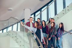 Happy teen girls and boys on the stairs school or college. Selective focus Royalty Free Stock Images