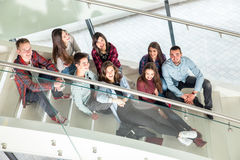 Happy teen girls and boys on the stairs school or college Royalty Free Stock Photos